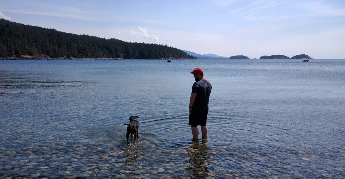 Odin and Jay wade in the Pacific Ocean outside of Vancouver