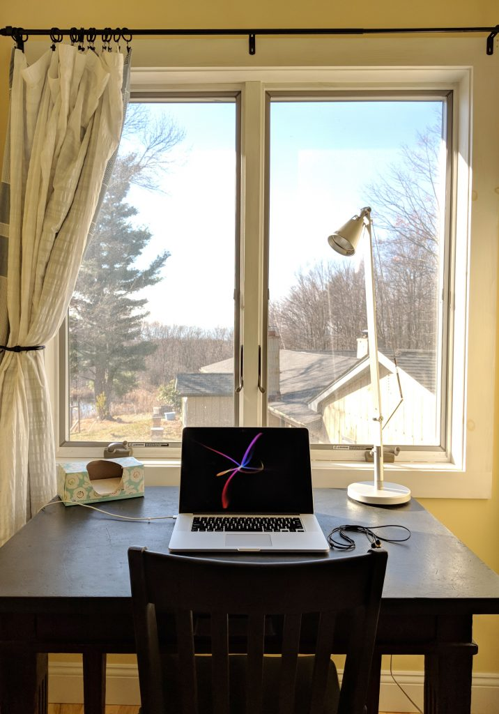 A clean laptop workstation overlooking the family run Retrograss Farm