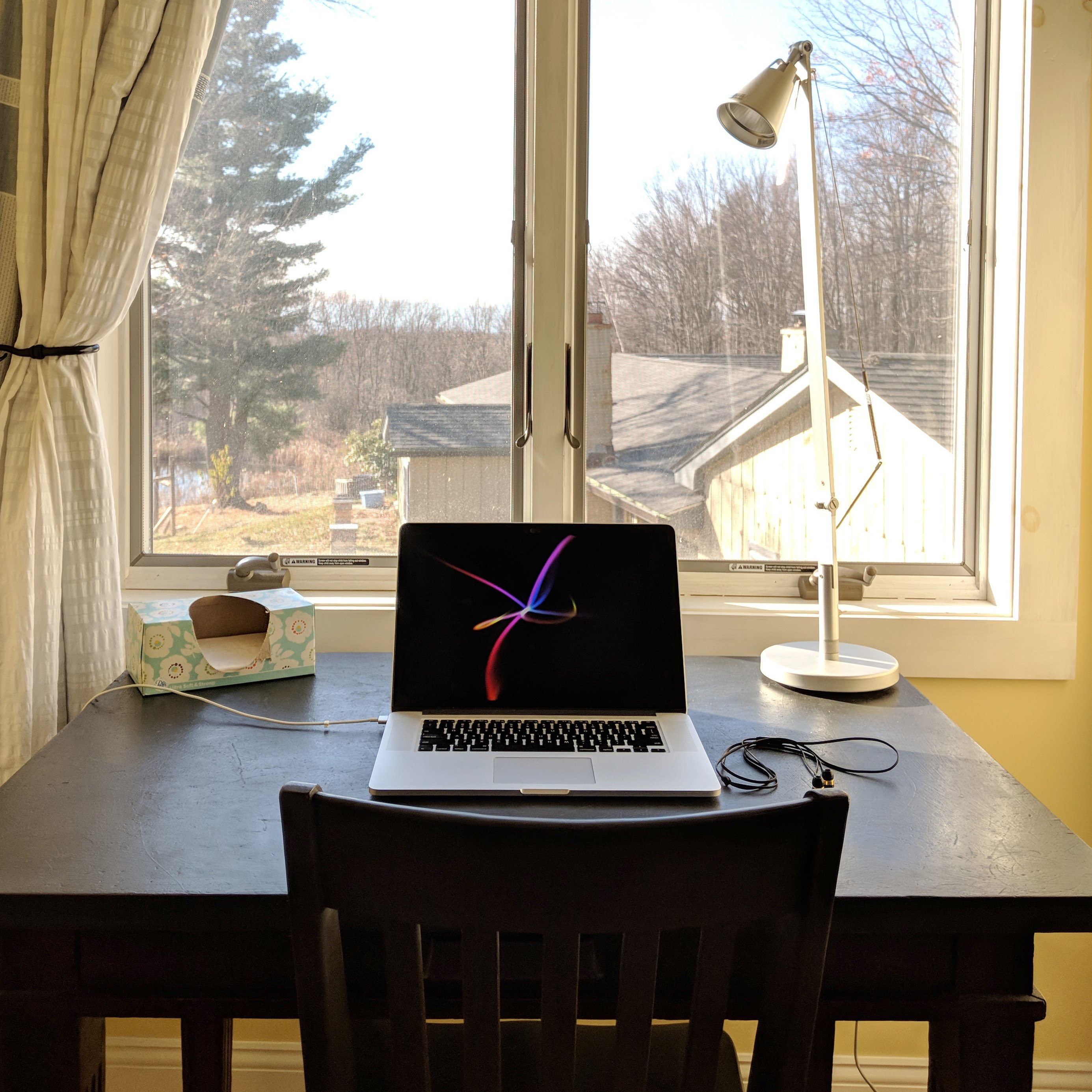 A focused workstation overlooking a small family farm in Ghent, New York