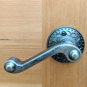 Polished brass door handle