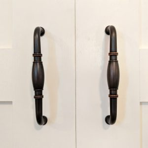 Brass closet handles on cream French closet doors