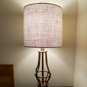 Brass bedside lamp with a burlap cloth lampshade