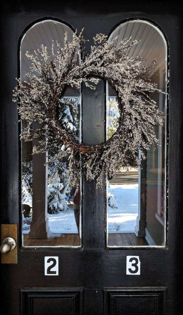 Door with holiday wreath