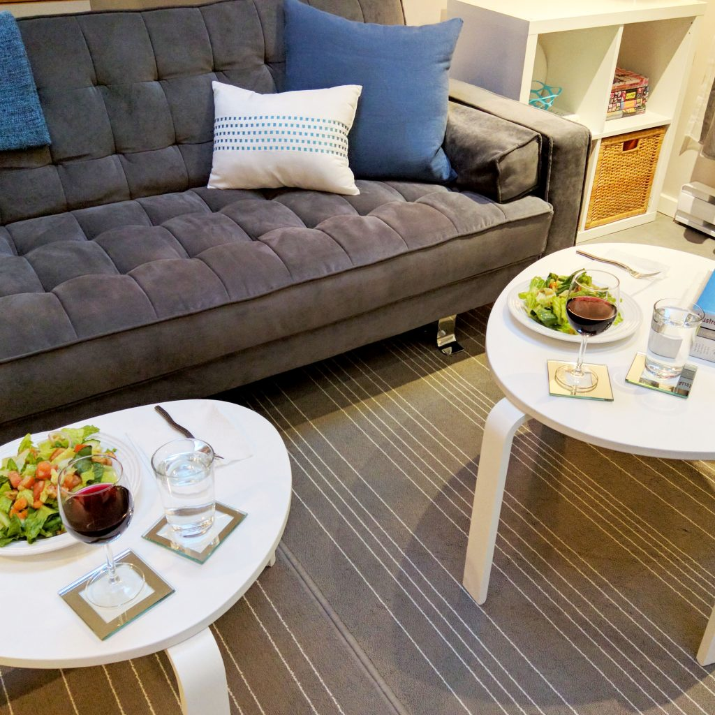 dinner on two coffee tables in front of couch
