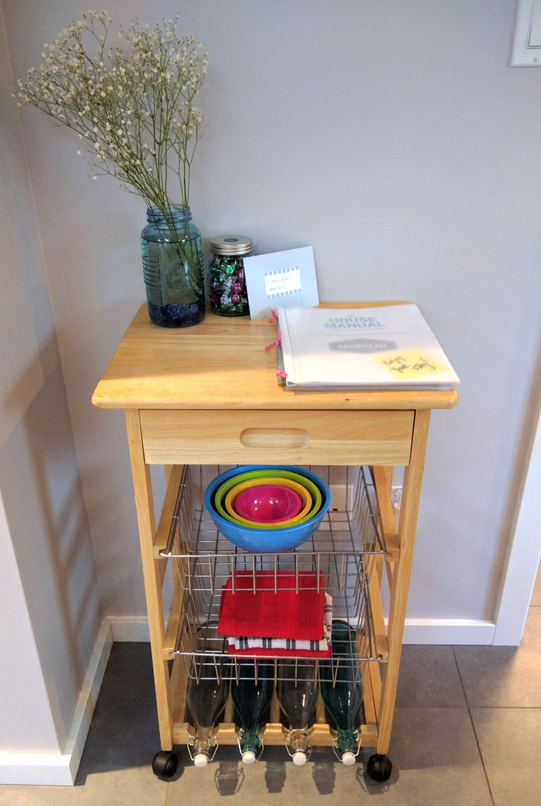 Cute kitchen cart with wire baskets and a house manual