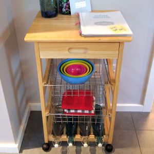 wooden rolling kitchen cart with colorful bowls