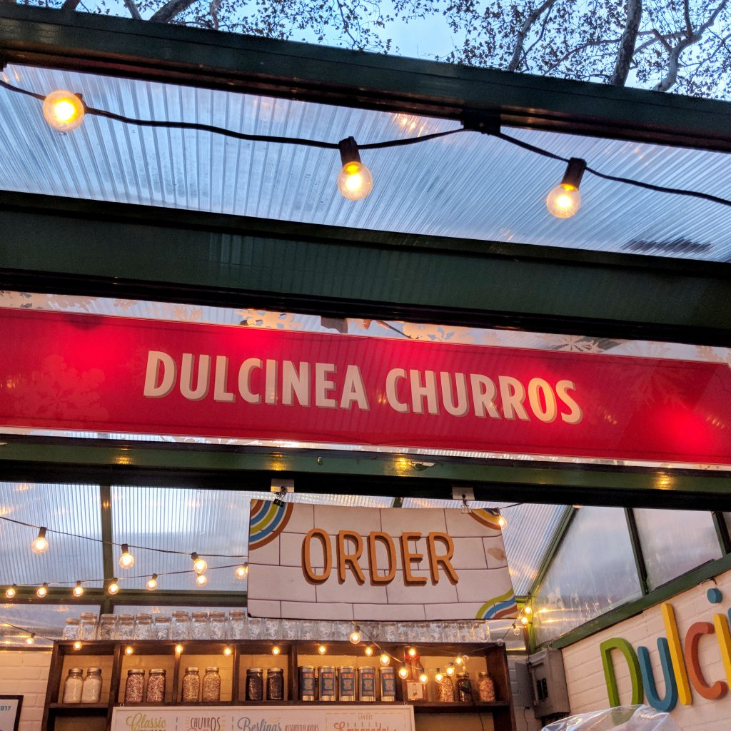 a holiday churros stand in bryant park