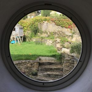 Circular window looking upon garden