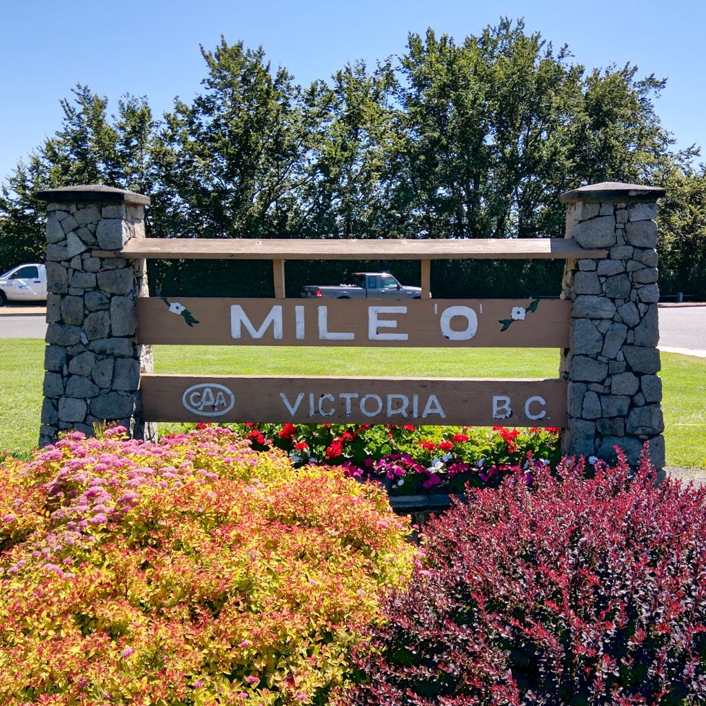 the sign for mile 0 in victoria canada