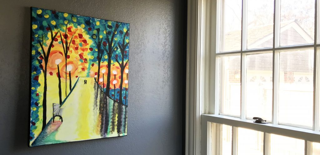 colorful painting next to a bright window