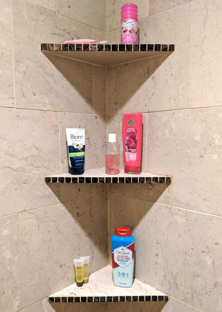 three shelves inside a shower