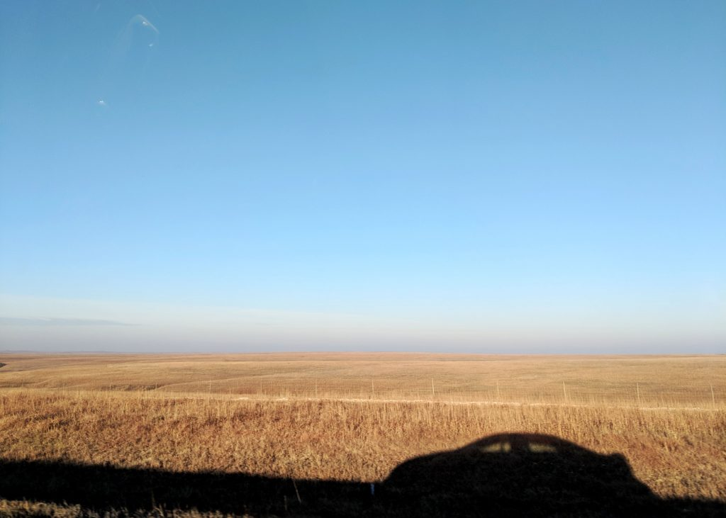 silhouette of car in flint hills in Kansas