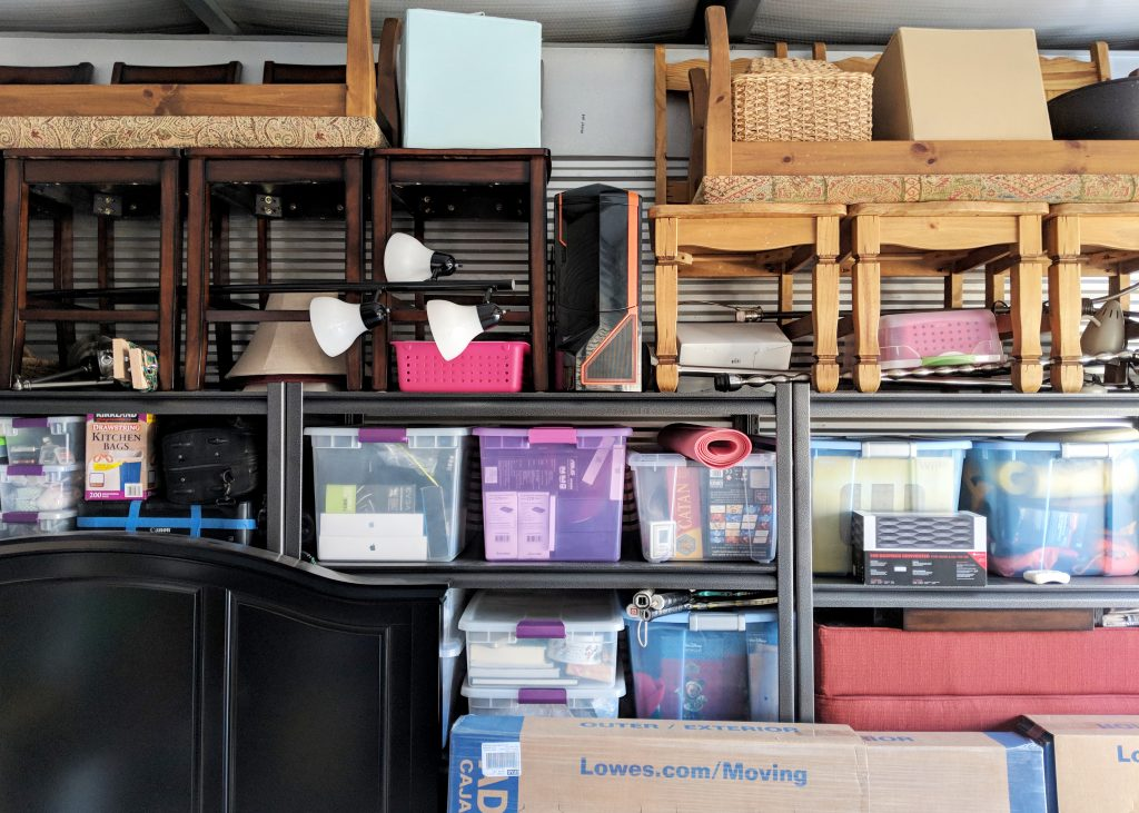 storage unit with shelves and bins