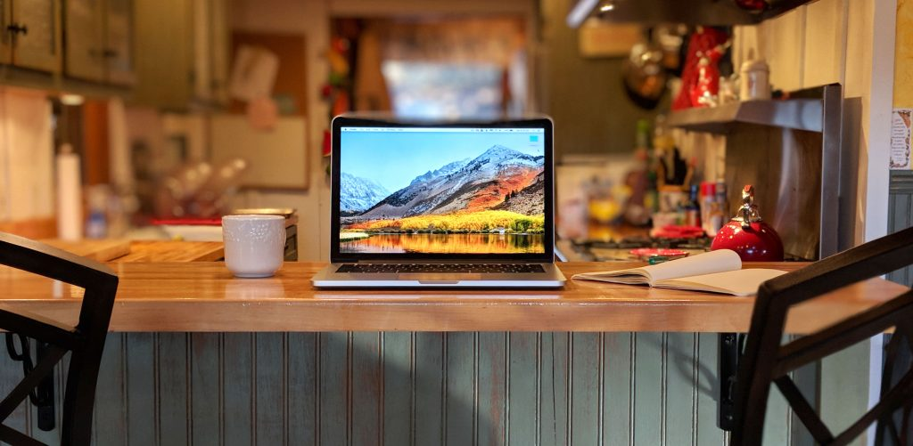 laptop on kitchen countertop