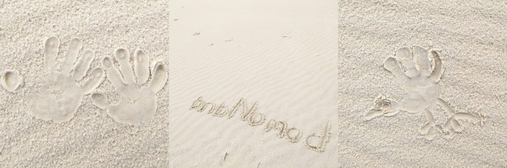 Drawings in the sand: handprints, bnbNomad, and a hand turkey