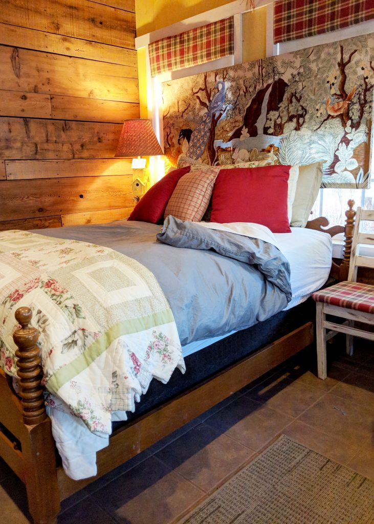 comfy bed in cabin in the woods