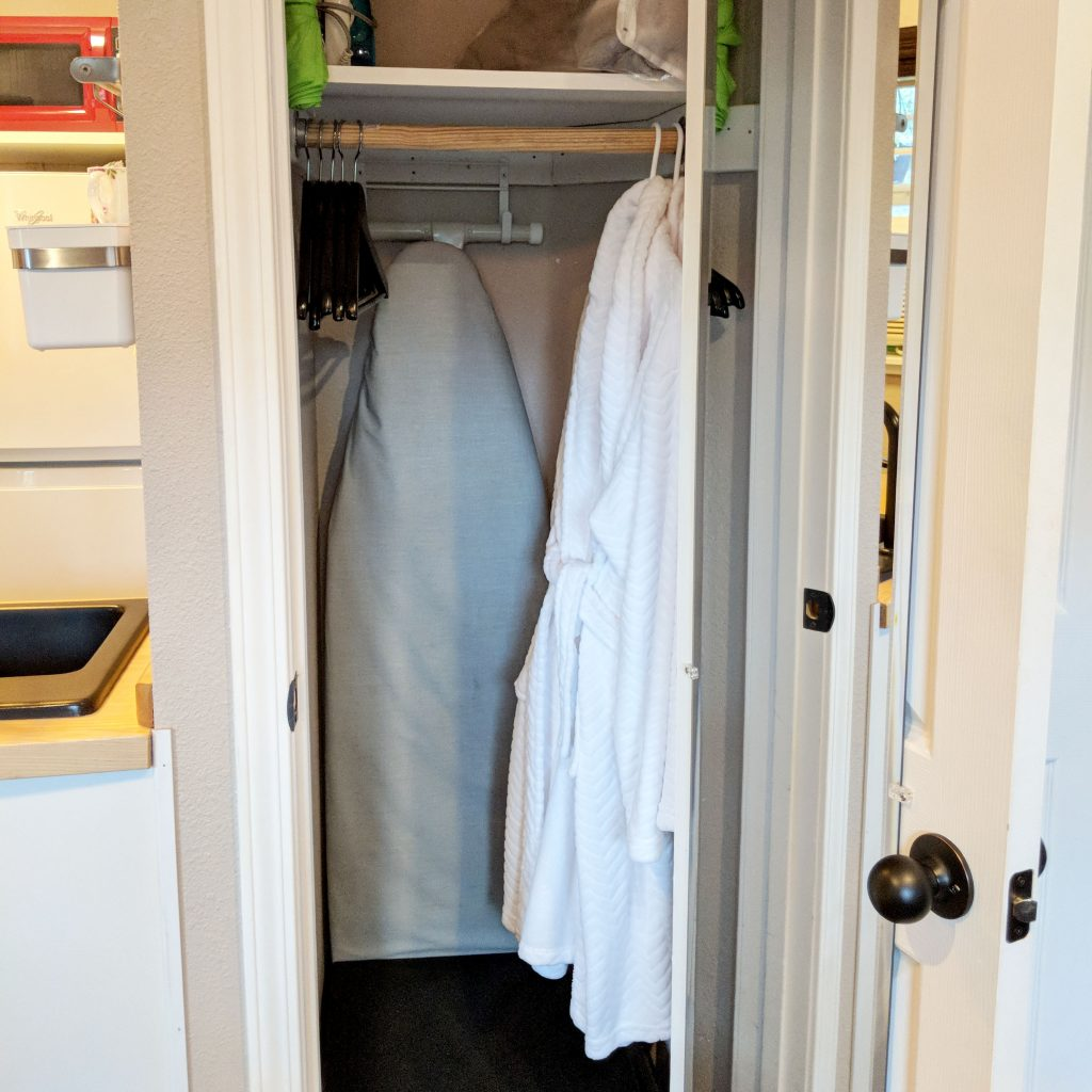 open closet with bathrobes