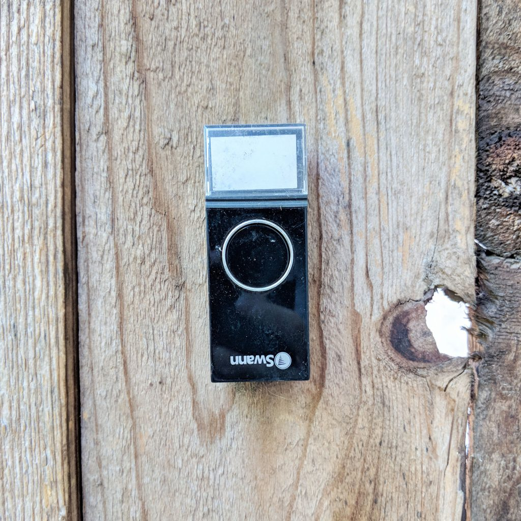 doorbell on fence