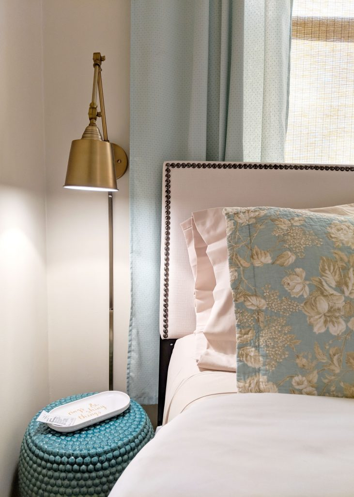 gold lamp and teal night stand