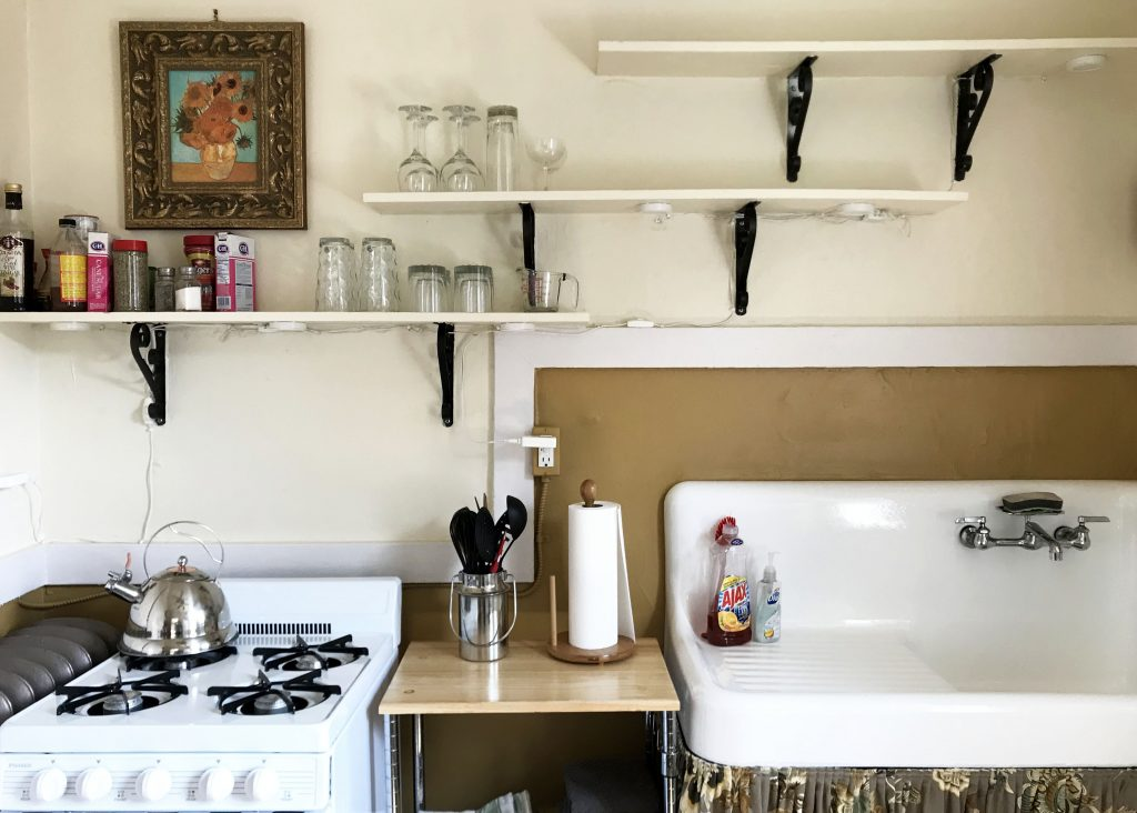 kitchen shelves with rustic farm sink