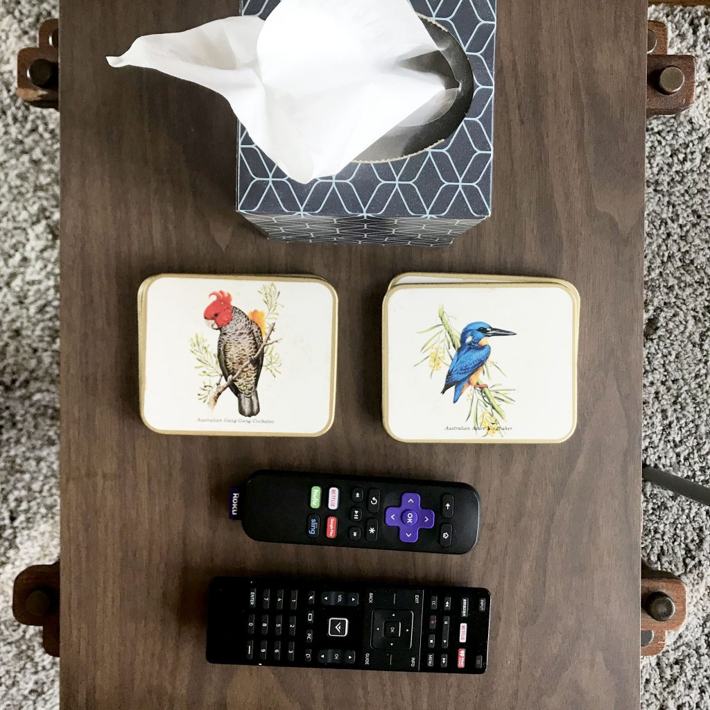 coasters and remotes on an end table