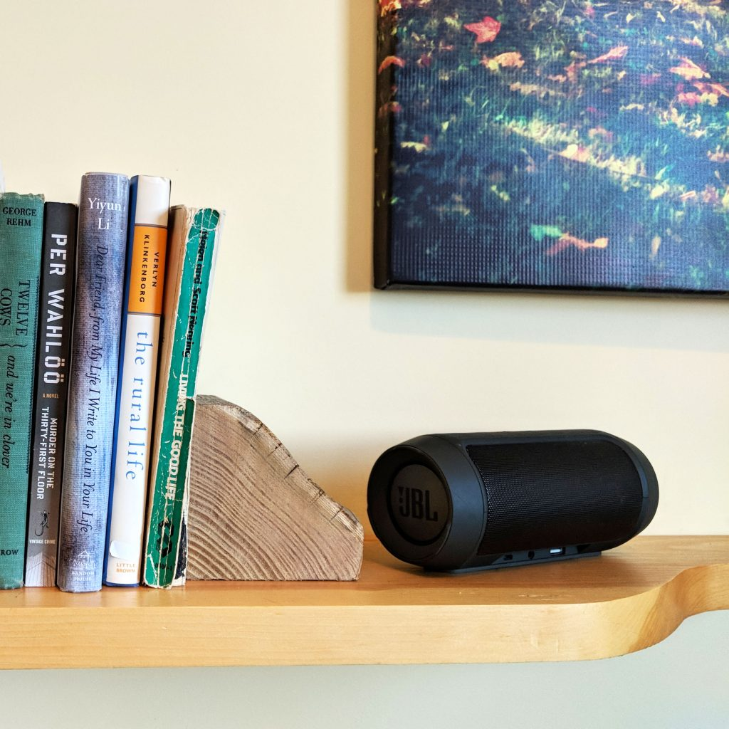 small speaker next to books
