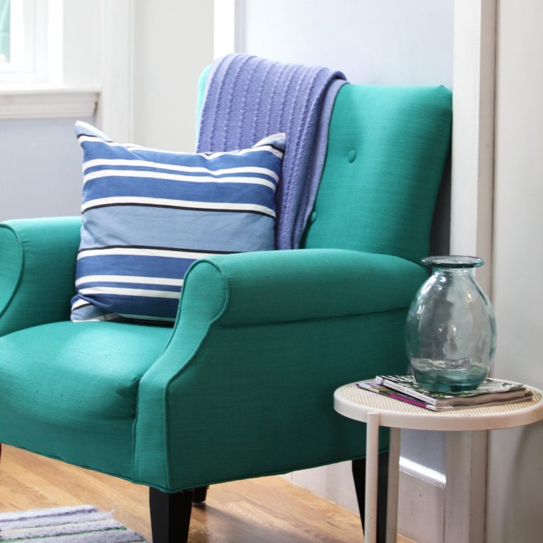 teal chair with blue cushions