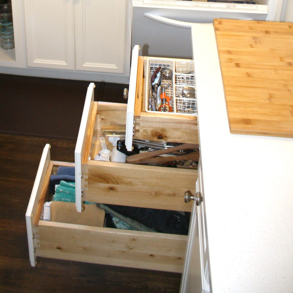 kitchen island with cutting board and drawers