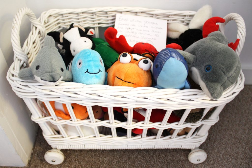 basket of stuffed animals for kids