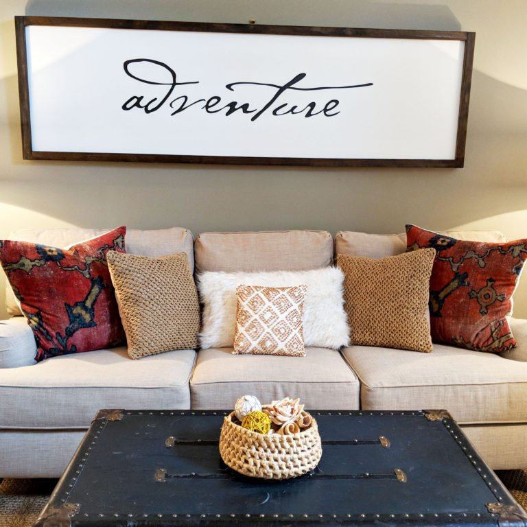 living room in Soulard Airbnb with adventure sign over the couch