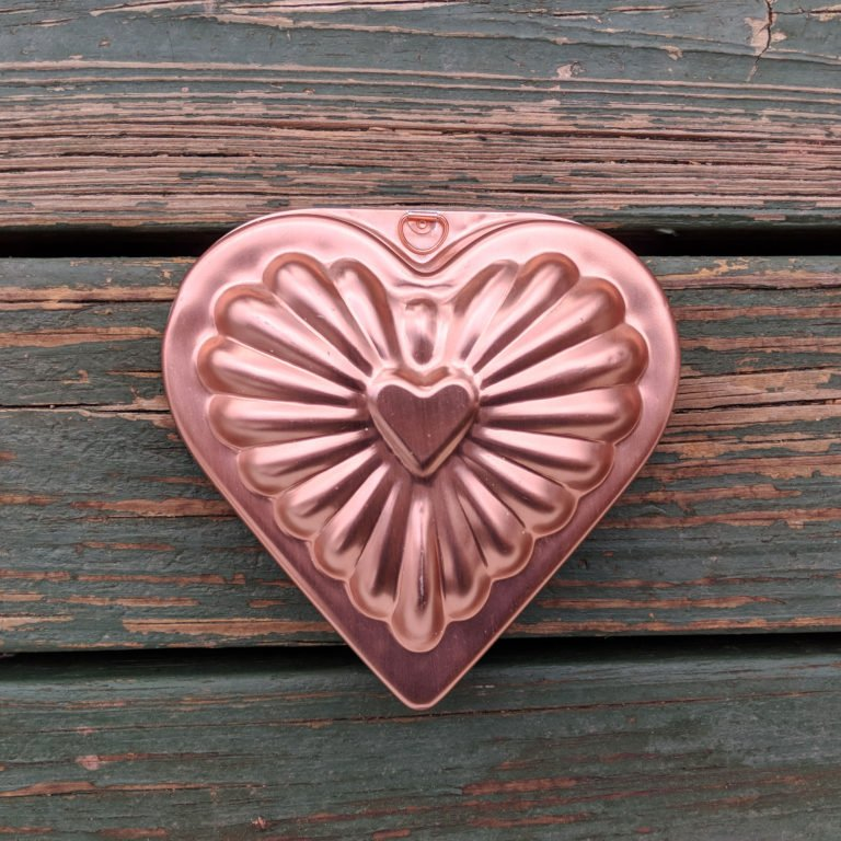 pink heart cake mold on wooden slats