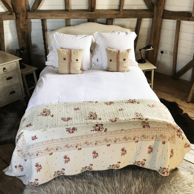 beautifully made bed in Airbnb in Kent countryside