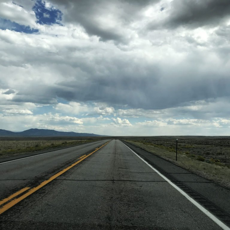 bnbNomad Airbnb travels road in Wyoming