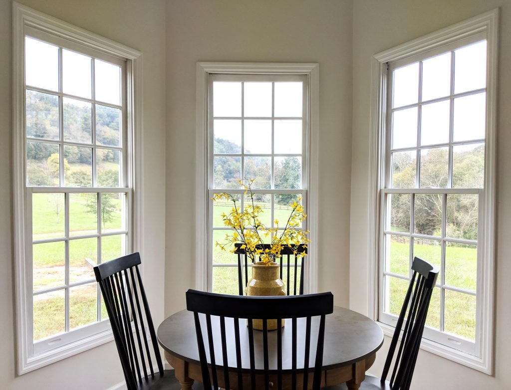 Three windows in dining room at Oak and Hare Farms Be Our Guest Throw Pillow in Tennessee Airbnb