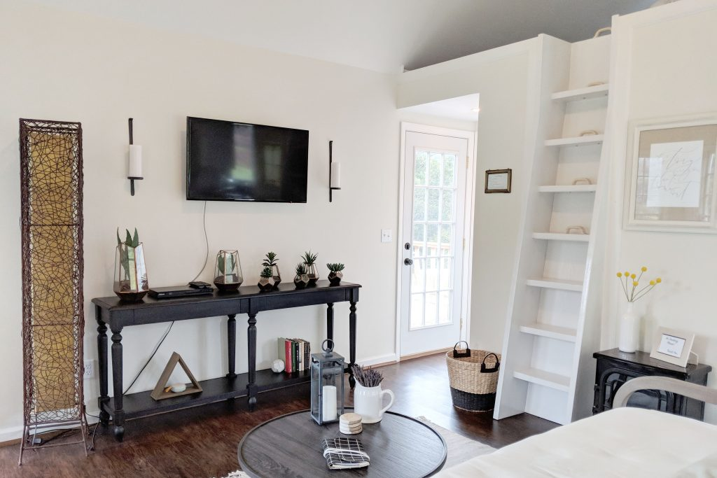 bright living room and ladder to lofted bedroom at the cottage at oak and hare farms a Tennessee Airbnb