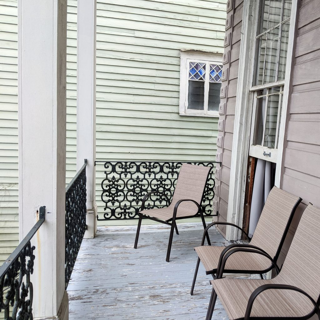 upper porch with chairs in New Orleans Airbnb