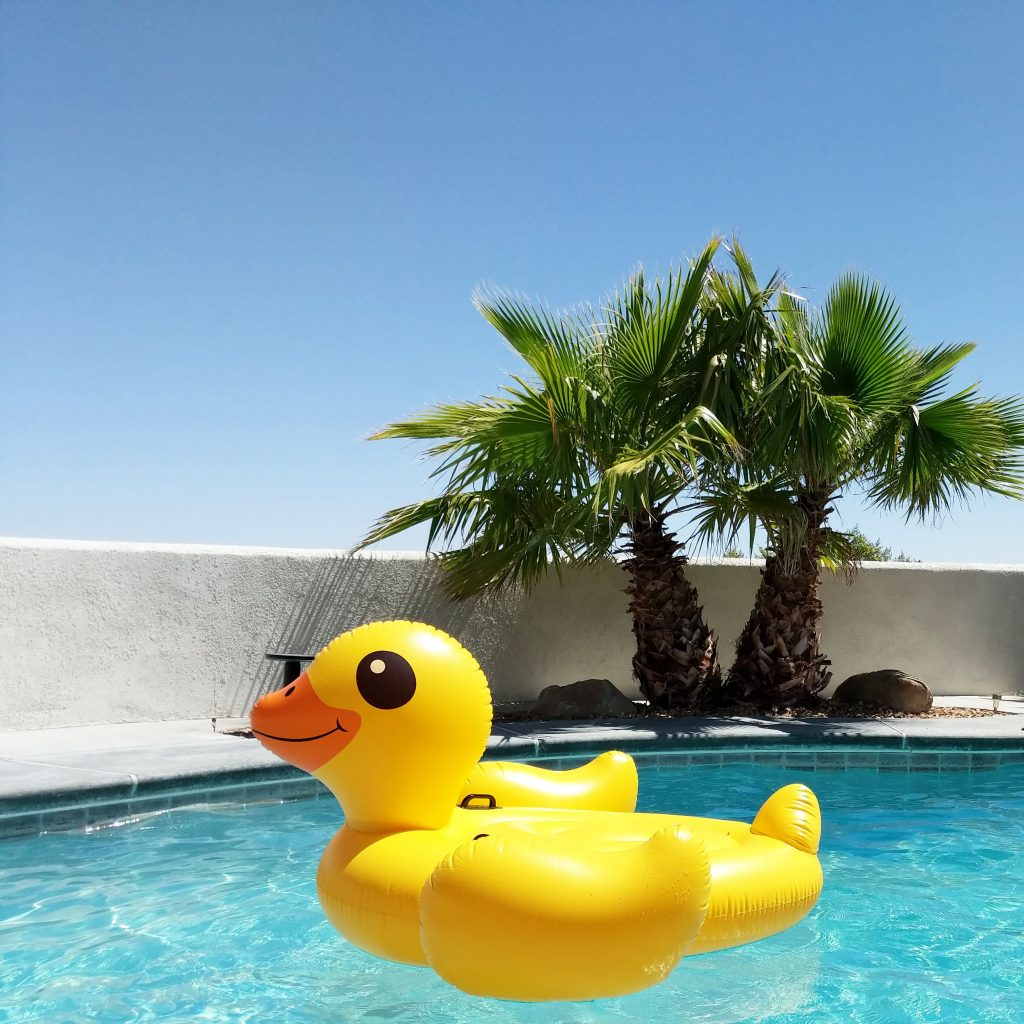big yellow duck floatation in pool
