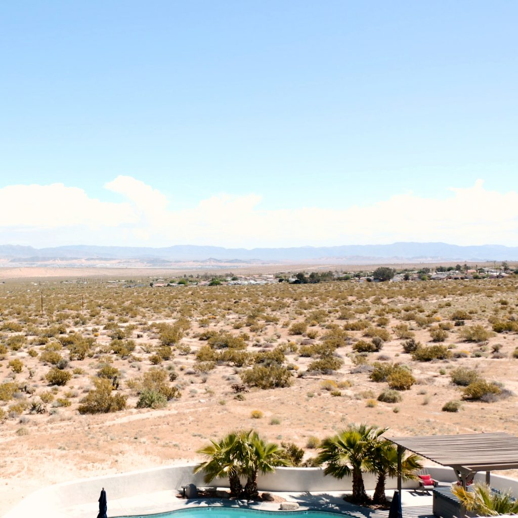 view from the sky of desert and pool