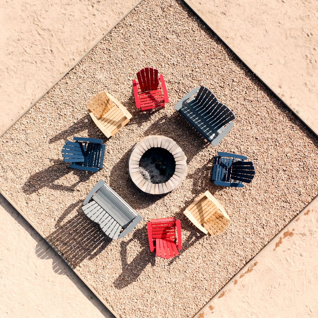 drone view of seats around a fire pit