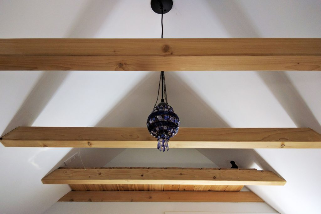 looking up at a ceiling with exposed beams