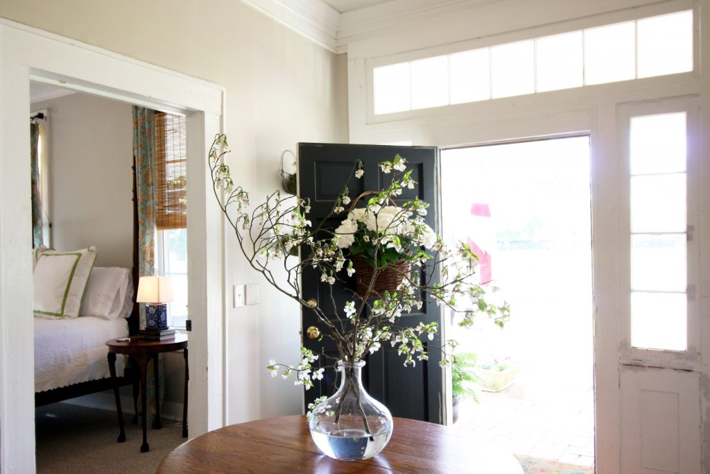 Airbnb photos with entry way flowers