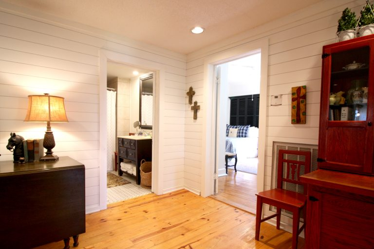 Airbnb photos of bedroom and bathroom hallways